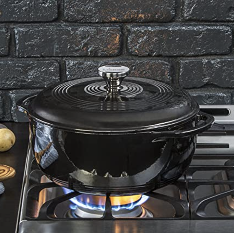 a black dutch oven on a stove top