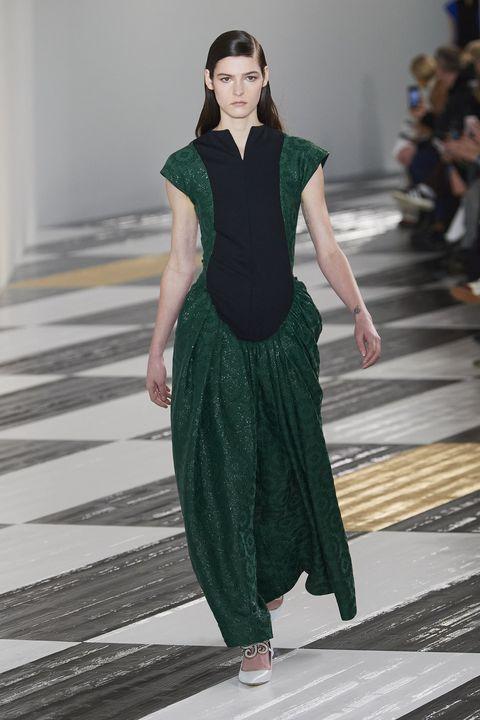 Fashion model, Runway, Fashion, Fashion show, Clothing, Green, Haute couture, Fashion design, Dress, Public event,