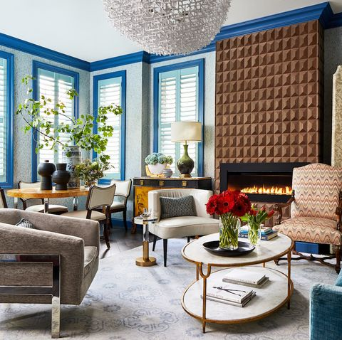 Living room, Room, Interior design, Furniture, Blue, Property, Building, Coffee table, Wall, House,