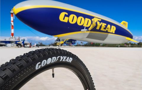 Automotive tire, Tire, Blimp, Yellow, Vehicle, Air travel, Automotive wheel system, Wheel, Inflatable, Airship,