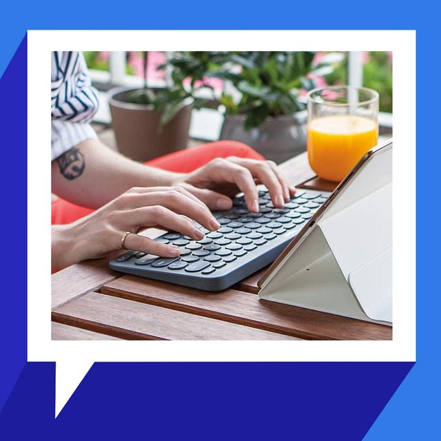 woman typing on logitech keyboard