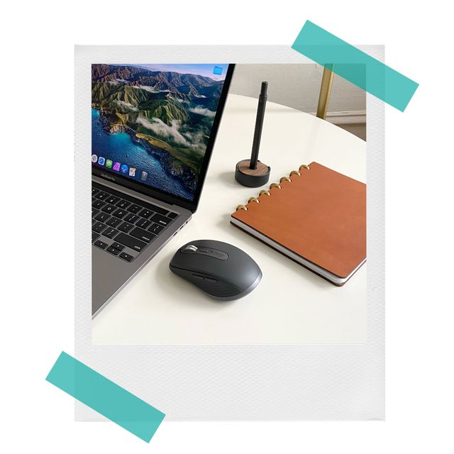 logitech mx anywhere 3 wireless mouse on desk with notebook and laptop