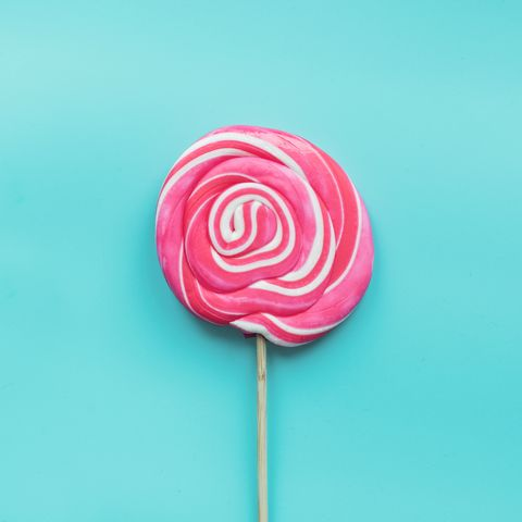 lollipops candy swirl white and pink on pastel blue