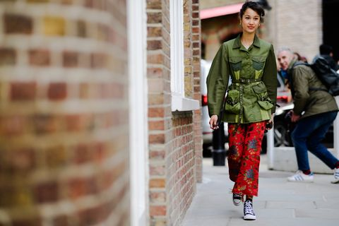 Street fashion, Fashion, Red, Clothing, Snapshot, Standing, Pattern, Jacket, Textile, Design,