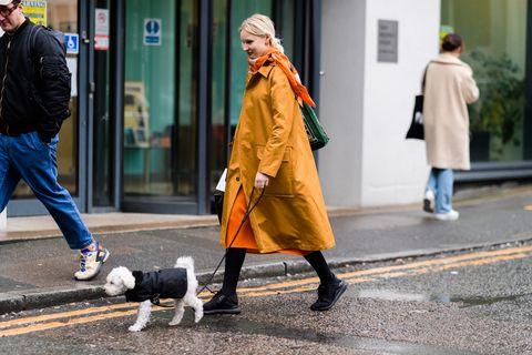 Street fashion, Photograph, Yellow, Fashion, Snapshot, Street, Human, Infrastructure, Outerwear, Pedestrian,