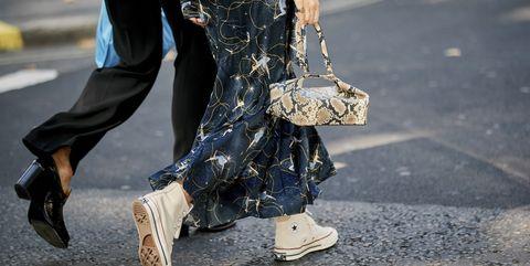 Street fashion, Footwear, Fashion, Shoe, Leg, Jeans, Human leg, Design, Ankle, Asphalt,