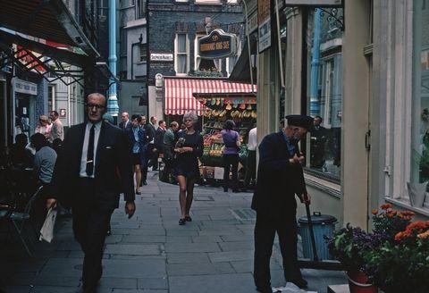 Urban area, People, Street, Pedestrian, Town, Snapshot, Human settlement, City, Public space, Standing,