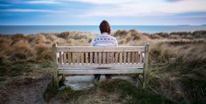 lonely woman on beach bench