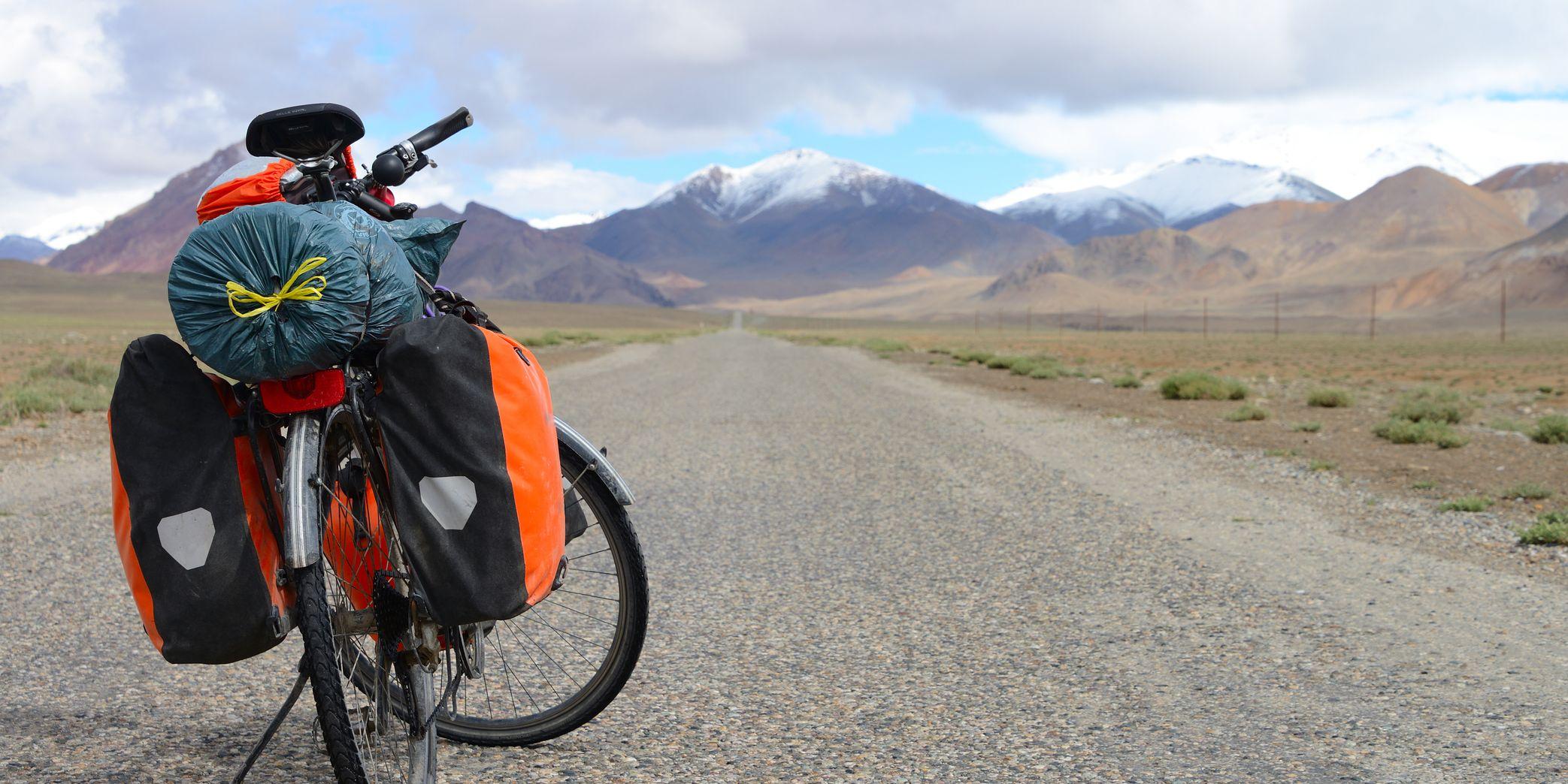 Long distance cycling on M41 Pamir Highway, Pamir Mountain Range, Tajikistan