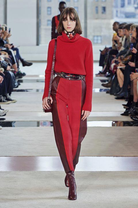 Fashion model, Fashion, Fashion show, Runway, Clothing, Red, Haute couture, Waist, Neck, Shoulder,