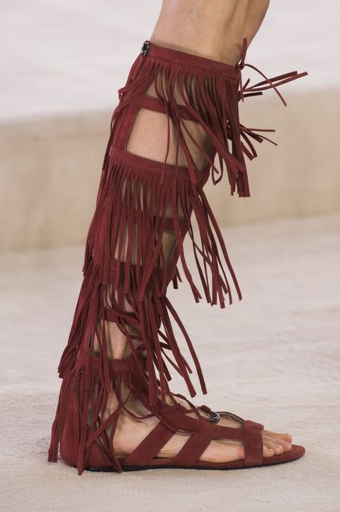6bcebb4a140 Fringe made an appearance on Longchamp s runway in the form of these  knee-high gladiator sandals