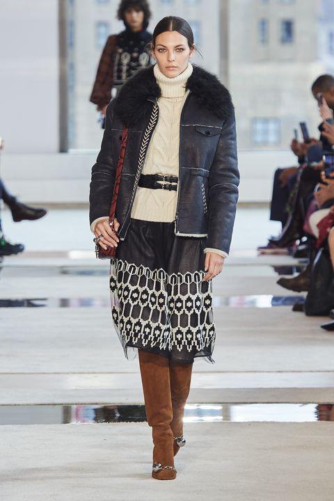 Fashion model, Fashion, Fashion show, Runway, Clothing, Street fashion, Outerwear, Footwear, Jacket, Haute couture,
