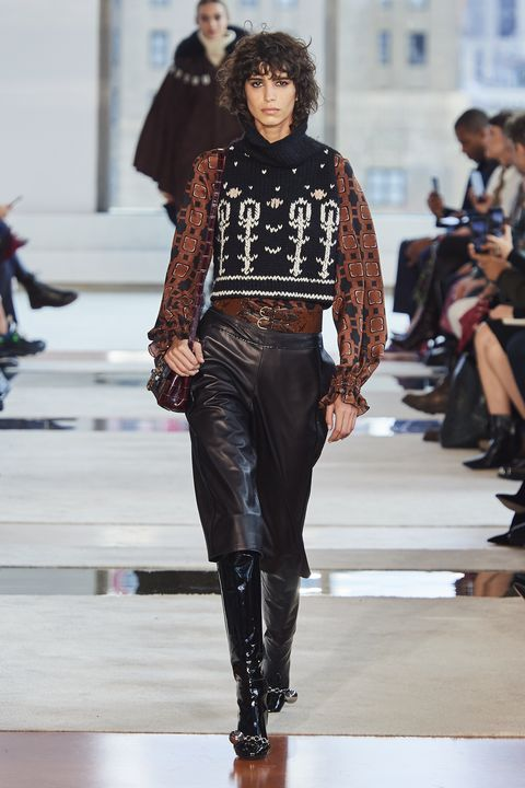 Fashion show, Fashion model, Runway, Fashion, Clothing, Street fashion, Leather, Waist, Jeans, Shoulder,