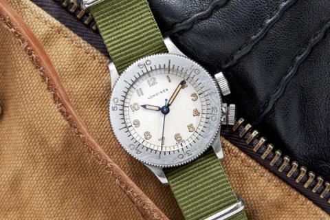 Analog watch, Watch, Watch accessory, Strap, Fashion accessory, Material property, Wrist, Jewellery, Hardware accessory,