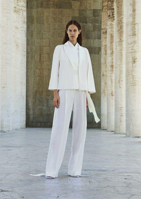 Sleeve, Standing, Formal wear, Street fashion, Blazer, Beige, Pantsuit, Suit trousers, Fashion design, Fashion model,