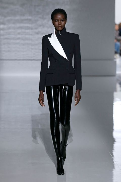 Fashion model, Fashion, Fashion show, Runway, Clothing, Suit, Formal wear, Outerwear, Blazer, Fashion design,