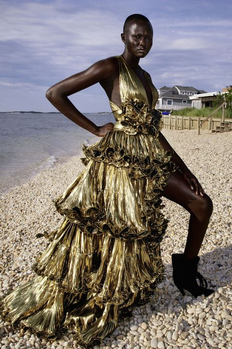 model in gold ruffled dress