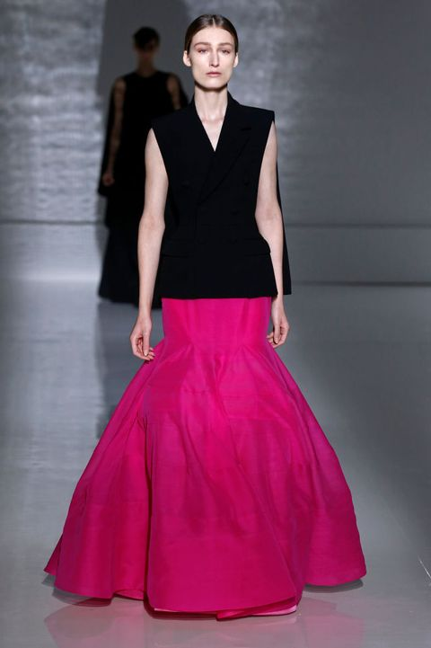 Fashion model, Fashion, Haute couture, Fashion show, Clothing, Dress, Runway, Pink, Shoulder, Neck,