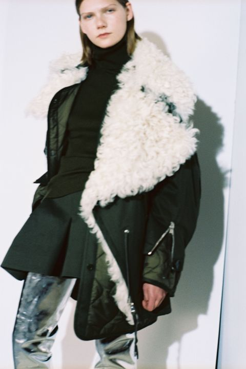 Clothing, Sleeve, Shoulder, Winter, Textile, Joint, Standing, Fur clothing, Jacket, Street fashion,