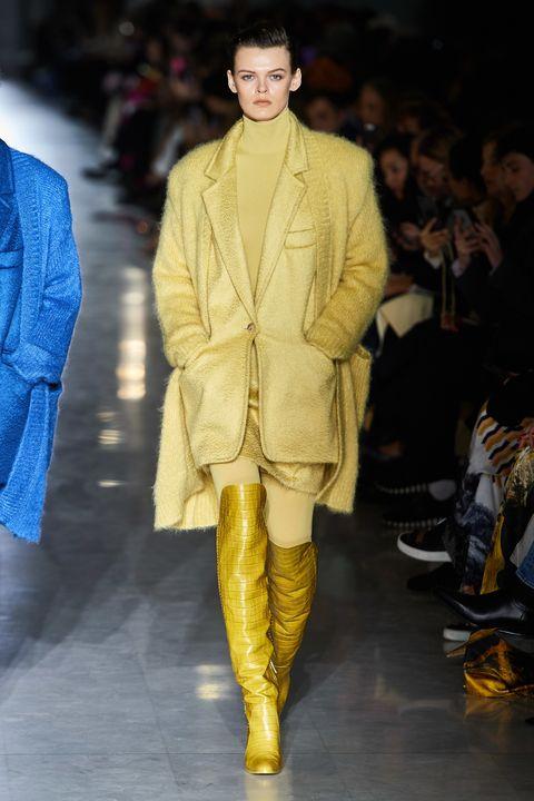 Fashion model, Fashion show, Fashion, Runway, Clothing, Yellow, Outerwear, Human, Haute couture, Event,