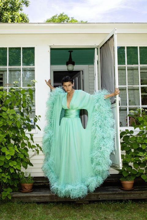 model in green feather dress