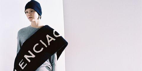 Sleeve, Cap, Street fashion, Projection screen, Fashion model, Baseball cap, Fur, Boot, Whiteboard, Fashion design,