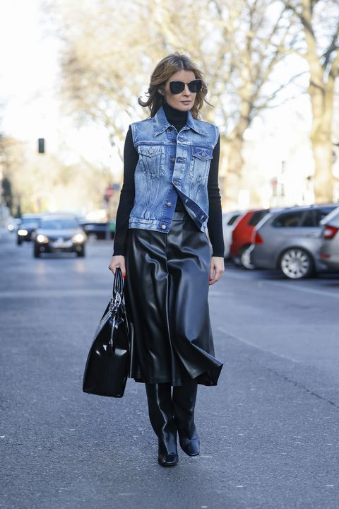 duesseldorf, germany   december 20 influencer gitta banko wearing a light blue denim jeans vest by maison margiela, black leather skirt pants by maison margiela, a oversize shiny black bag by maison margiela, black knee high boots by coperni and sunglasses by mykita during a street style shooting on december 20, 2020 in duesseldorf, germany photo by streetstyleshootersgetty images