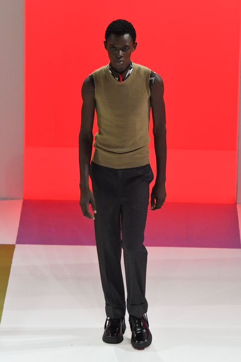 Fashion, Runway, Fashion show, Fashion model, Clothing, Red, Standing, Orange, Fashion design, Human,