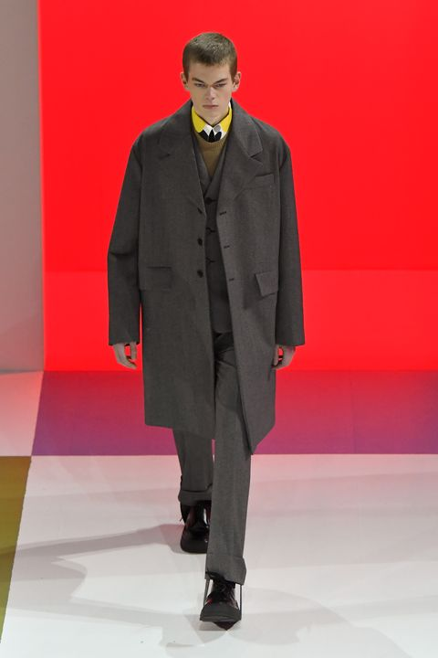 Fashion, Runway, Clothing, Fashion show, Suit, Fashion model, Outerwear, Overcoat, Human, Formal wear,