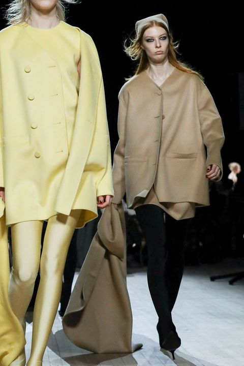 Fashion model, Fashion, Fashion show, Clothing, Runway, Outerwear, Fashion design, Human, Overcoat, Haute couture,