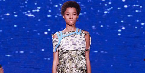 Fashion model, Red carpet, Fashion, Fashion show, Clothing, Runway, Carpet, Dress, Flooring, Event,