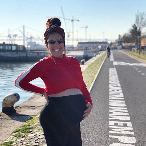 Clothing, Red, Fashion, Street fashion, Beauty, Crop top, Eyewear, Shoulder, Footwear, Design,