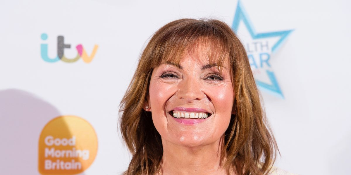 Lorraine Kelly looks sophisticated in a camel M&S shirt with long sleeves