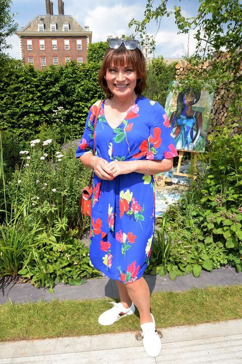 Lorraine Kelly rocks bold floral Phase Eight dress and Topshop shoes