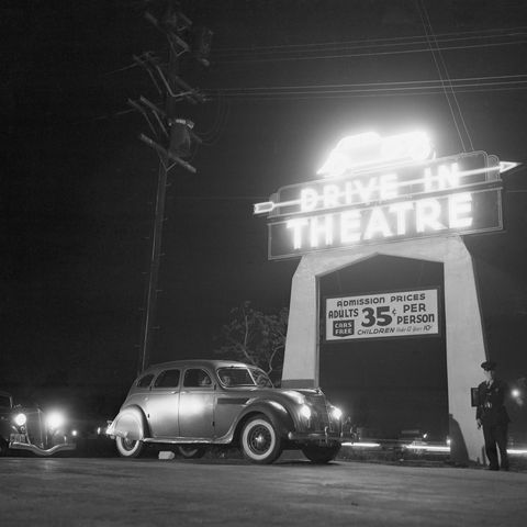 cars waiting to enter drive in theatre