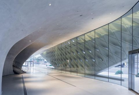 Architecture, Infrastructure, Glass, Commercial building, Grey, Space, Concrete, Parallel, Composite material, Transparent material,