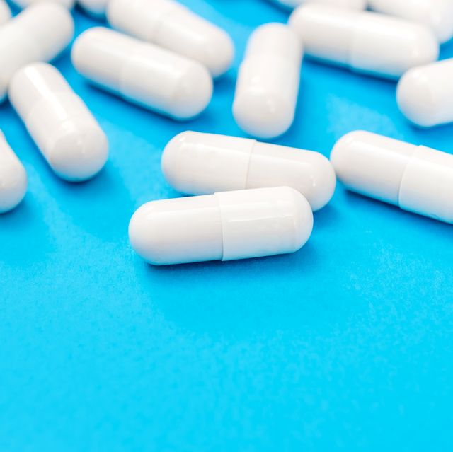 white antidepressant pills on a blue background