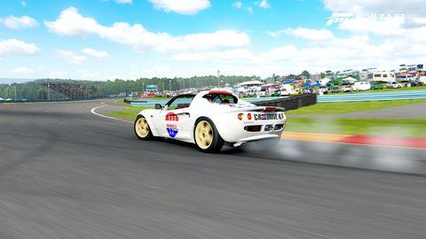 Land vehicle, Vehicle, Car, Sports car racing, Motorsport, Sports car, Auto racing, Performance car, Racing, Coupé,
