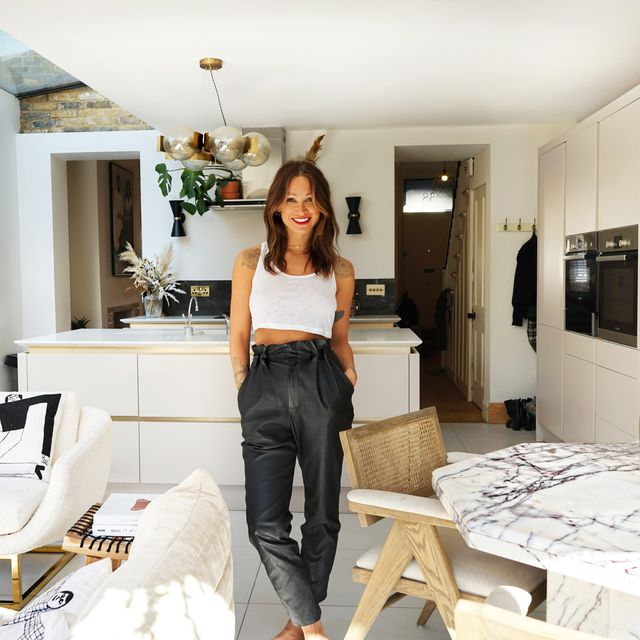 inside lou teasdale's gold  white luxe kitchen