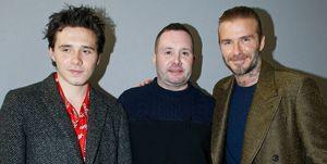 Brooklyn Beckham, Kin Jones y David Beckham en el desfile de Louis Vuitton