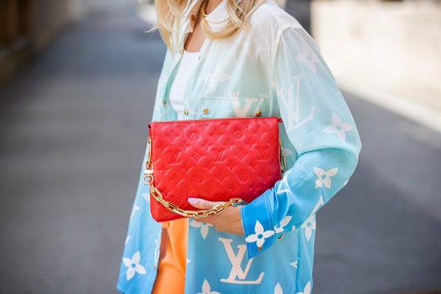 berlin, germany   july 16 sonia lyson is seen wearing nike sneakers, red louis vuitton bag, louis vuitton button shirt with logo print, orange pants zara, white cropped top on july 16, 2021 in berlin, germany photo by christian vieriggetty images