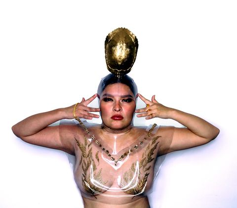 louise solomon photographed in her own creations 24k gold plated miigis shells, cedar sprays, and turtle clan
