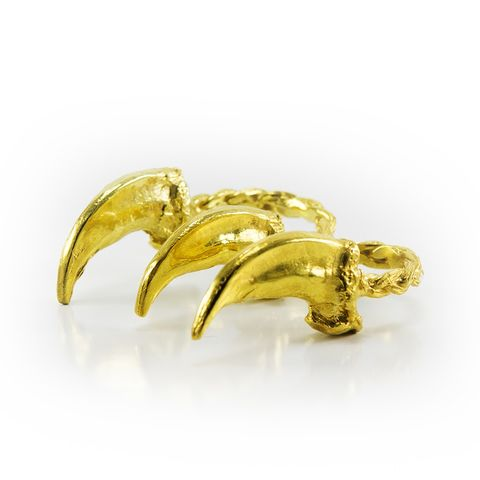 a two finger ring featuring 24k gold plated wolf claws by louise solomon
