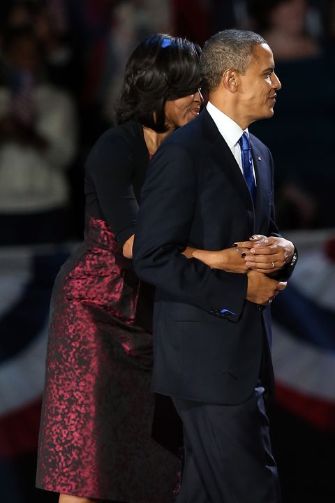 chicago, il   november 06  us president barack obama stands on stage with first lady michelle obama after his victory speech on election night at mccormick place november 6, 2012 in chicago, illinois obama won reelection against republican candidate, former massachusetts governor mitt romney  photo by scott olsongetty images
