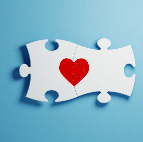 Love And Puzzle Concept - White Jigsaw Puzzle Pieces Forming A Red Heart