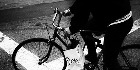 Cyclist carrying a bag that says love