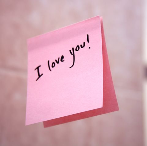 I love you pink post it note stuck to the wall