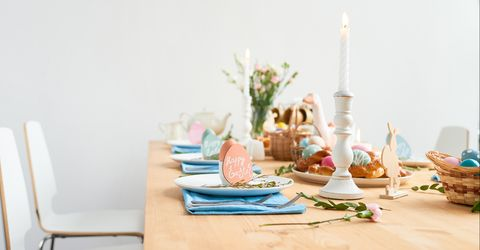 Hosting the perfect easter without all the stress easter party ideas decorated easter table with field flowers in vase burning candles painted easter eggs negle Gallery