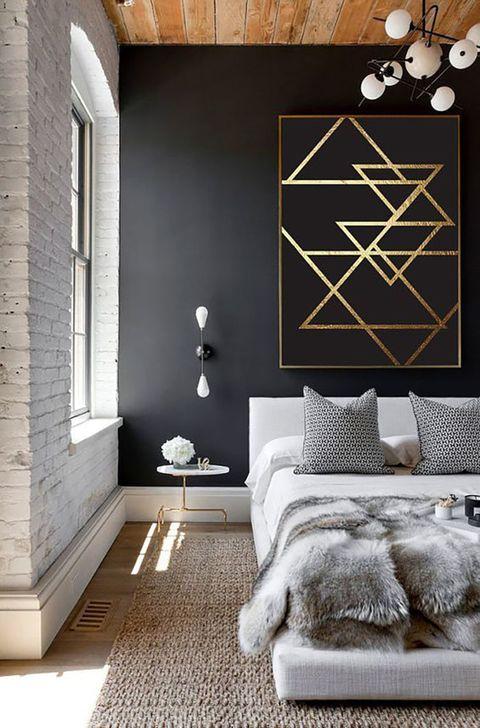 Dormitorio con cuadro con geométricos