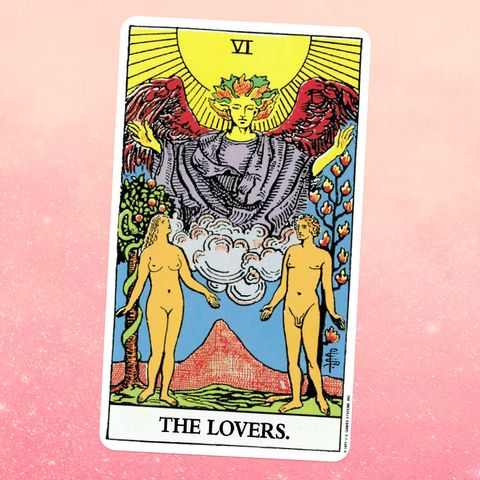 the tarot card the lovers, showing a nude man and woman standing near some trees, with an angel above them
